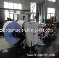 Biaxial center surface slitting and rewinding machine