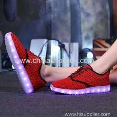 Red fly knitting shoes with LED lights exporter