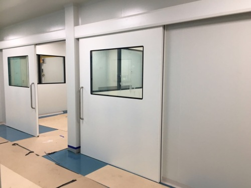 Manual sliding hermetic doors for clean rooms