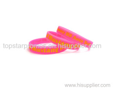 Debossed painted pink silicone wristbands for events