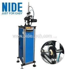 Electric motor rotor commutator deburring machine with brush