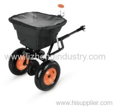 Towable seed/salt fertilizer spreader