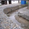 Flood line wall mesh gabions