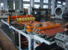 Wave board extruding machine