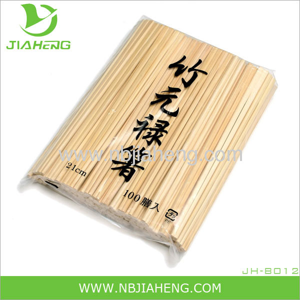 Natural bamboo chopsticks wrapped with open paper bag