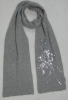 Acrylic knitted scarf with sequins