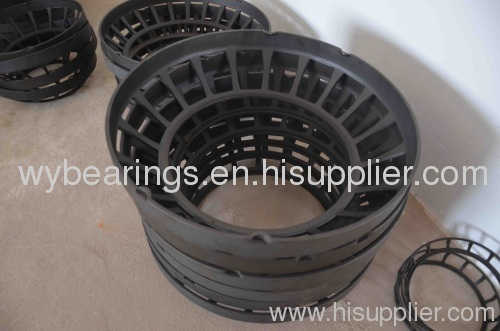Pressed cage for spherical roller thrust bearing