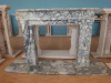 Freestanding stone fireplace frame