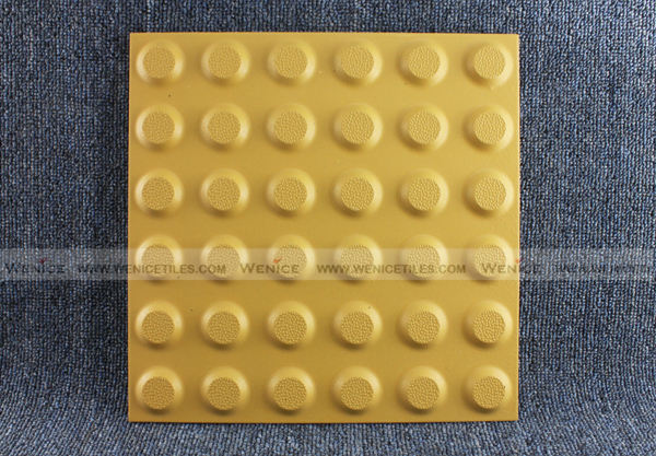 Tactile warning tile with dot design