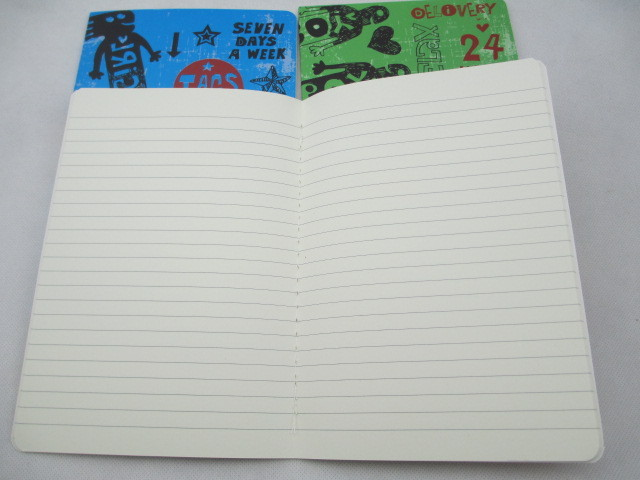 subjects notebook with scrawling cover