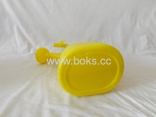 yellow plastic watering can