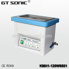 Stainless steel ultrasonic denture cleaner with basket