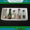 Plastic cavity packaging tray for wine bottles