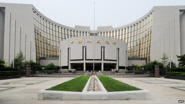 China cuts bank reserve ratio to boost lending
