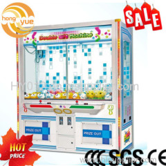 Coin operated toy grabbing game machine double luxury doll gift machine