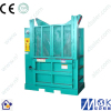 Cardboard baling strapping machine