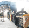 opened baler with semi-automatic strapping machine