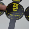 Paper sticker with coated paper and lamination material