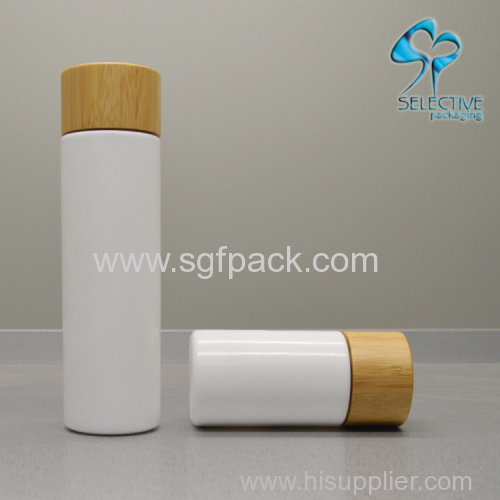 white porcelain vase glass bottle with bamboo cap or pump cosmetics bamboo packaing