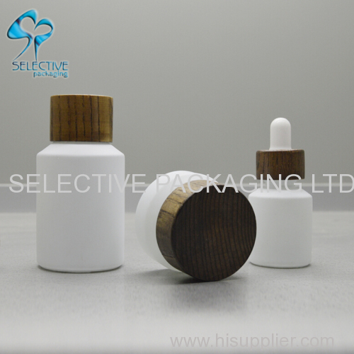 white coating inclined shoulder glass cosmetic packaging lotion bottle and cream jar series with ash wood screw lids
