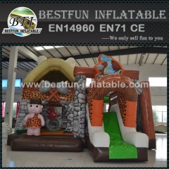 Stone age with dinosaur inflatable jumping castle with slide