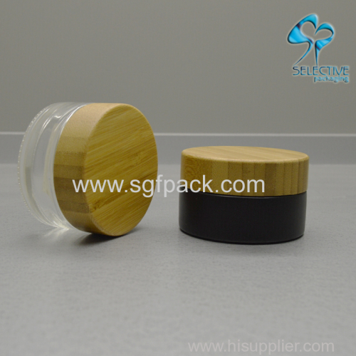 fancy 30ml 50ml black coating cosmetic glass jar for face cream with gold ring wood cap