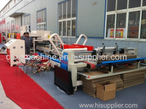 High speed automatic corrugated paper box folding and gluing machine