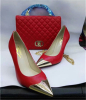 Gold metal toe high heel shoes and matching handbags