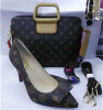Bowtie high heel shoes and matched handbag