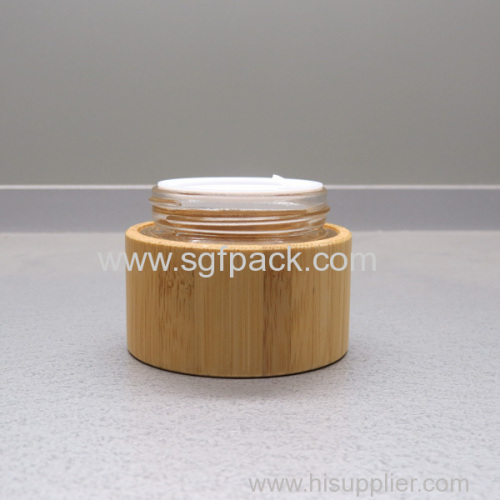 Glass cream jar wooden jar