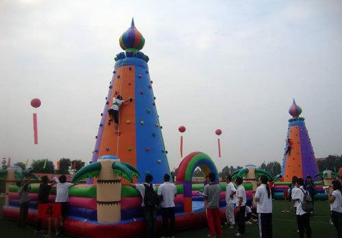 Excitement of inflatable rock climbing sport game
